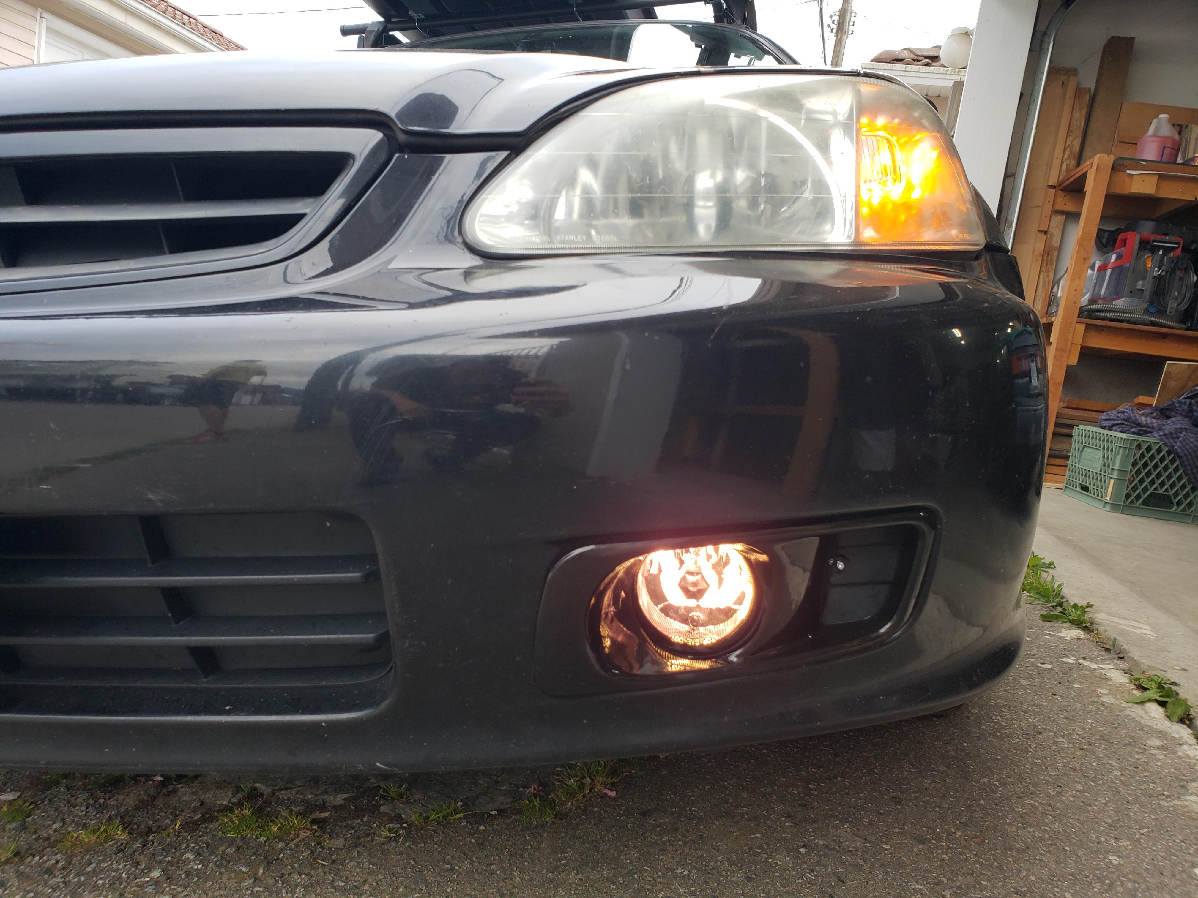 fog lights installed, bumper mounted (fog lights on, drivers side)