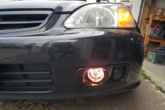 fog lights installed, bumper mounted (fog lights on, drivers side)